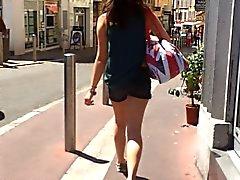 Following little brunette in street with hidden cam
