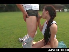 Outdoor sex picnic with Japanese teen giving BJ on knees