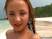 Petite teen babe on the beach getting