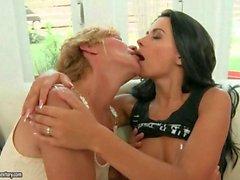 Brunette babe kisses and seduces a mature woman
