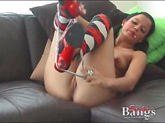 Pigtailed teen in pretty red lipstick fucks a toy