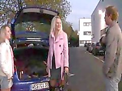 Two German teens are in a parking lot in public eating cock