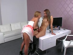 Brunette babe and female agent licking each other