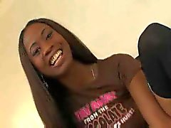 Slender chocolate teen playing with her dildo