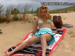 Sexy teen masturbate on the hot beach