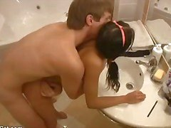 Teen and her man bang in the bathroom