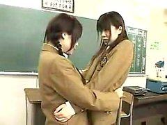 Two sweet Oriental babes getting their holes devoured in th
