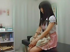 Young innocent Japanese teen gets a rectal exam from the doctor