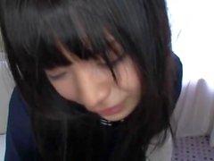 Japanese schoolgirl in school uniform having sex shyly