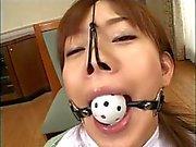 Stunning Japanese lass gets a facial cumshot in bdsm scene