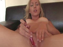 blonde lass has a glass dildo she uses on her