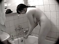 Busty girl showers on hidden camera