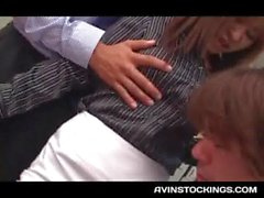Stockinged Japanese teen having a passionate threesome at work