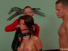 Young naked couple submits to their mistress