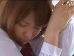 Teen chick petting in a bus