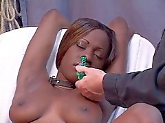 Young black girl has her pussy stretched out with a speculum after clip play