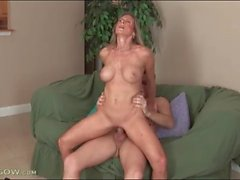 Freckled mature slut rides big hard young cock