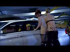 Two hottie lesbians do some strap-on sex in a deserted carpark