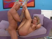 Tight ass blonde fucked on a purple sofa then cummed on her pussy