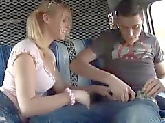 Pigtailed girl giving handjob in car
