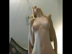 Skinny young blonde babe with a pair of nice tits gets fucked on a blue couch