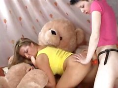 Two girls,one teddy bear