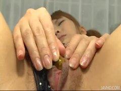 Soccer playing Japanese babe Nagisa toying pussy in fishnet panties
