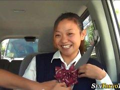 Asian teen blows in car
