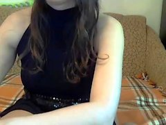 Foxy blonde teen doing striptease and fingering