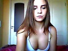 Pretty brunette teen takes off her bra to fondle her nice b