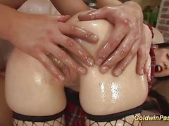 Oiled babe gags on this hard dick