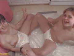 Diaper Sluts teen lesbians piss for each other
