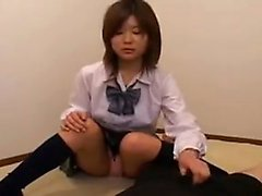 Naughty Japanese teen sends her hands working their magic o