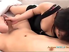 Hot Milf With Glasses Giving Blowjob For Young Guy On The Bed In The Hotel