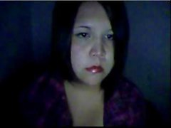 Chubby little brunette on her webcam poses and rubs her slit