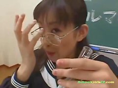Schoolgirl With Glasses Sucking Guys In The Classroom
