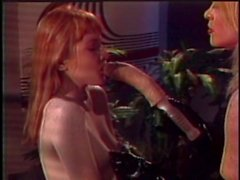Redhead teased by blond mature whore