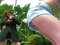Mature lesbian whore fucks young pussy outdoors with strapon