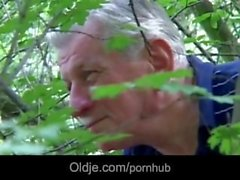 Horny grandpa gets pleased by huge tits blonde slut near a forest
