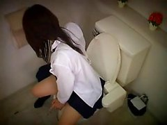 Asian teen sits on the toilet and lets imagination control