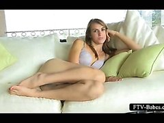 Sensual teeny exploring her craving pussy on the couch