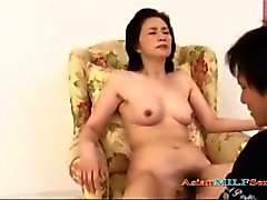 Mature Asian Woman Getting Her Hairy Pussy Fingered Licked By Young Guy On The Armchair