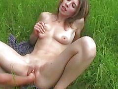 Brunette fisted outdoors