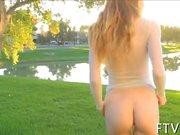 fun loving teen in the garden shows off her flexibility