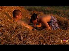 Teens having sex on a pile of hay