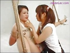 Mature Woman Hanging In Bondage Rubbed With Food Kissing Nipples Pinched By Young Girl