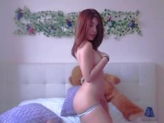 camgirl playing with teddy in bed
