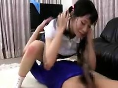 Pigtailed Asian teen has a horny boy giving her deep bangin