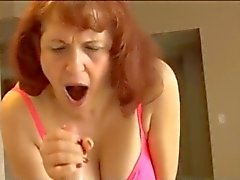 Horny granny does a good handjob