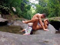 Curly teen banged beside a flowing stream